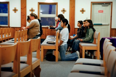 People attend Mass at St. John by the Sea Church in Klawock on Prince of Wales Island in southeastern Alaska. Catholics make up slightly less than 2 percent of the island's 6,000 residents. (CNS/Nancy Wiechec)