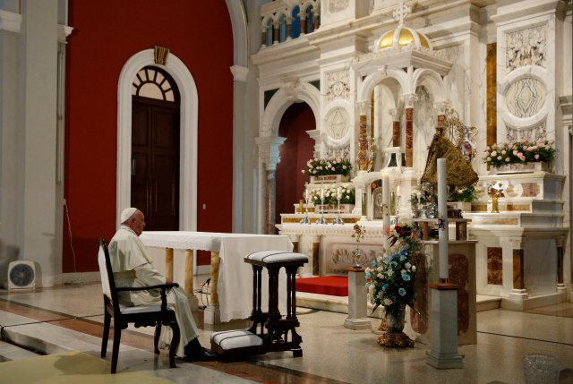 Pope Francis prays near the statue of Our Lady of Charity, patroness of Cuba, in the Minor Basilica of the Shrine of Our Lady of Charity in El Cobre, Cuba, Sept. 21. He returned there the following morning to celebrate Mass. (CNS/Paul Haring)