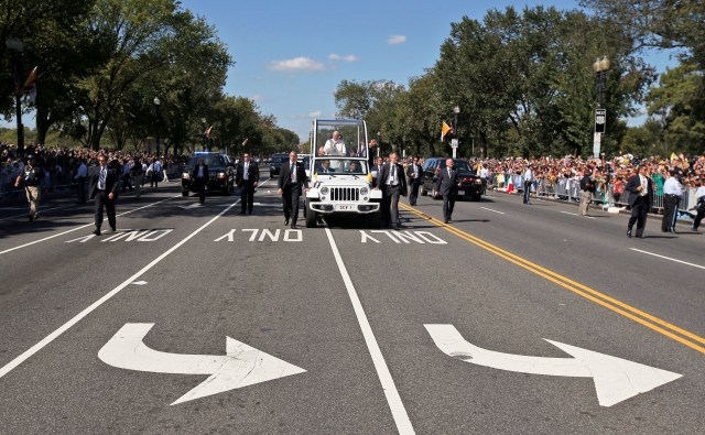 Pope Francis waves to the crowds from the popemobile as he makes his way down Constitution Avenue in Washington Sept. 23. (CNS/Alex Brandon, pool)