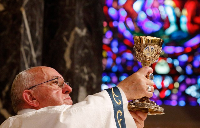 Pope Francis raises the chalice as he celebrates Mass at the Cathedral Basilica of SS. Peter and Paul in Philadelphia Sept. 26. (CNS/Paul Haring)