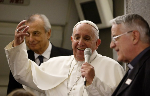 Pope Francis speaks with journalists aboard his flight from Philadelphia to Rome Sept. 27. (CNS/Paul Haring)