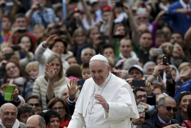 Pope Francis arrives to lead his weekly audience in St. Peter's Square at the Vatican Sept. 30. (CNS/Reuters)