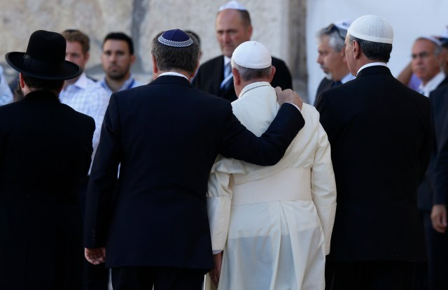 "Pope Francis walks with Argentine Rabbi Abraham Skorka, left, and Omar Abboud, a Muslim leader from Argentina, as he leaves after praying at the Western Wall in Jerusalem in this May 26, 2014, file photo. In his official proclamation of the Holy Year of Mercy, Pope Francis called for ""fervent dialogue"" between Christians, Muslims and Jews. (CNS/Paul Haring)"