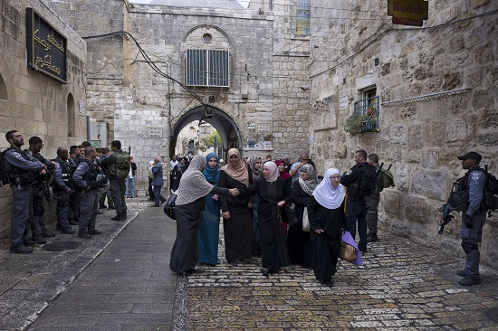 Israeli and border police stand guard Oct. 9 near a gate to the compound known by Muslims as the Haram al-Sharif and by Jews as the Temple Mount in Jerusalem. (CNS photo/Jim Hollander, EPA)