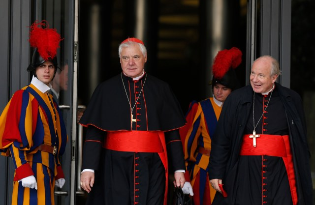Cardinal Gerhard Muller, prefect of the Congregation for the Doctrine of the Faith, and Austrian Cardinal Christoph Schonborn of Vienna leave a session of the Synod of Bishops on the family at the Vatican Oct. 14. (CNS photo/Paul Haring)