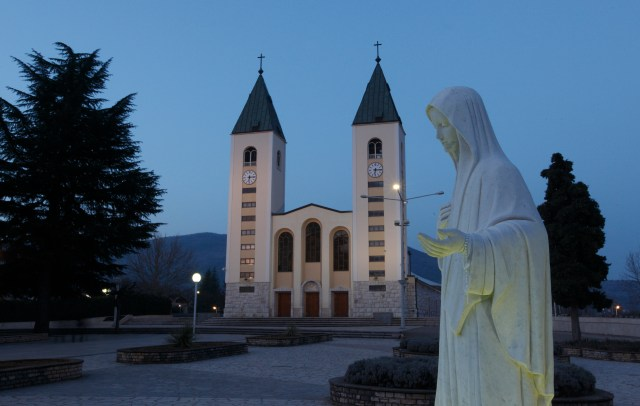 A statue of Mary is seen outside St. James Church in Medjugorje, Bosnia-Herzegovina, in the early morning in 2011. Reports of alleged Marian apparitions at Medjugorje began 30 years ago. (CNS file/Paul Haring)
