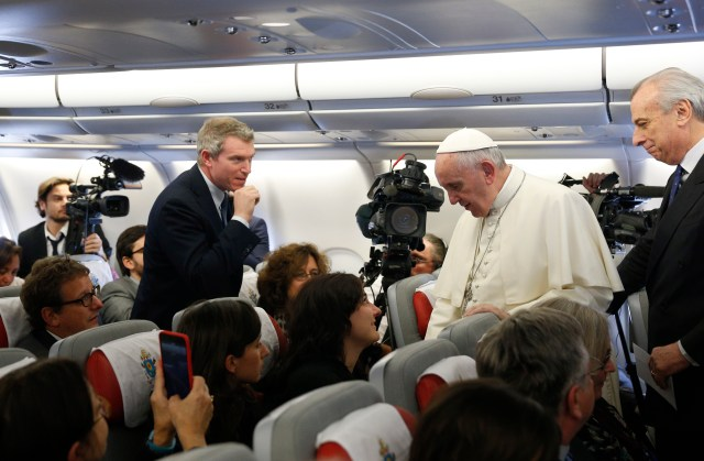 Pope Francis greets journalists aboard his flight from Rome to Nairobi, Kenya, Nov. 25. The pope is visiting Kenya, Uganda and the Central African Republic during his six-day African tour. (CNS/Paul Haring)