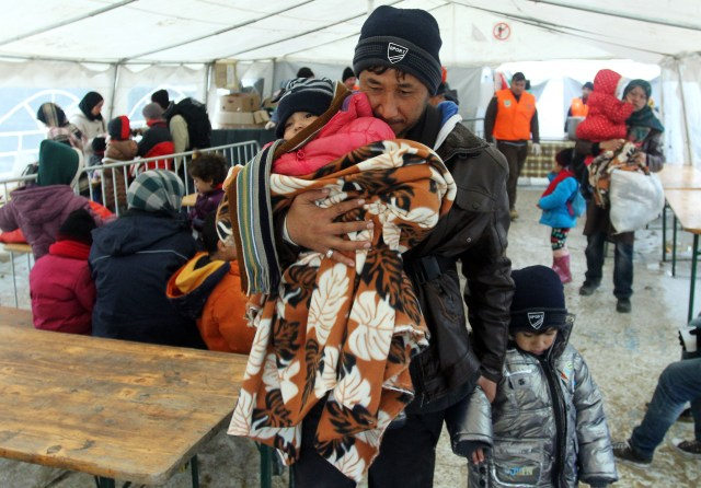 Migrants from Syria, Iraq and Afghanistan arrive at the transit and registration camp in the town of Presevo, southern Serbia, Nov. 24. (CNS/EPA)