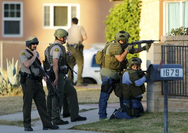 Police officers conduct a manhunt after a mass shooting at the Inland Regional Center in San Bernardino, Calif., Dec. 2. (CNS/Reuters)