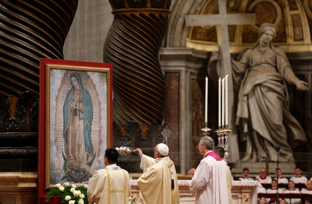 Pope Francis uses incense to venerate an image of Our Lady of Guadalupe during Mass marking her feast Dec. 12. (CNS photo/Paul Haring)