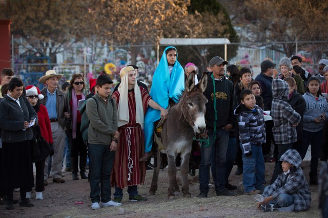 "People from the U.S. and Mexico take part in a ""posada,"" the commemoration of Mary and Joseph's search for shelter, Dec. 20 in Nogales, Mexico. The annual Nogales event held by the Kino Border Initiative and Dioceses Without Borders reflected on the struggles of migrants and migrant families. (CNS/Nancy Wiechec)"