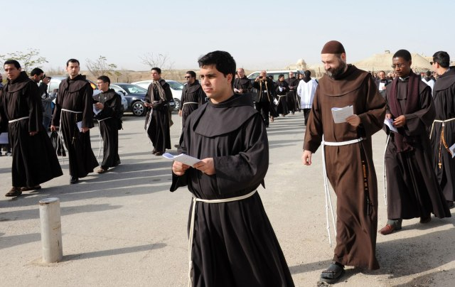Franciscan brothers walk in a procession to attend Mass in a celebration of the feast of the Baptism of the Lord in 2012. Located near the West Bank town of Jericho, the site is believed to be the place where St. John baptized Jesus. (CNS file/Debbie Hill)