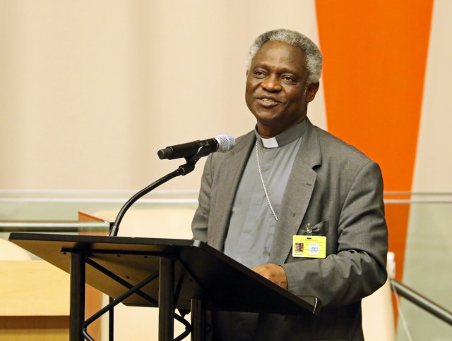 Ghanaian Cardinal Peter Turkson, president of the Pontifical Council for Justice and Peace, addresses the audience during a presentation on Pope Francis' encyclical on the environment June 30 at U.N. headquarters in New York City. The cardinal addressed world leaders during a side event at the U.N. climate conference in Paris Dec. 8. (CNS photo/Gregory A. Shemitz)