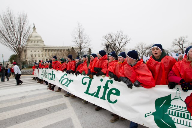 Young people walk with a banner past the U.S. Capitol in 2012 during the annual March for Life in Washington. (CNS/Bob Roller)