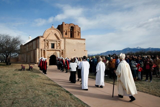 Bishop Gerald Kicanas of Tucson, Ariz., walks in procession to celebrate Mass outside the mission at Tumacacori National Historical Park in Tumacacori, Ariz., Jan. 10. The Mass was part of the park's Kino Legacy Day marking the 325th anniversary of the Jesuit missionary's first visit to an O'odham village there. (CNS/Nancy Wiechec)