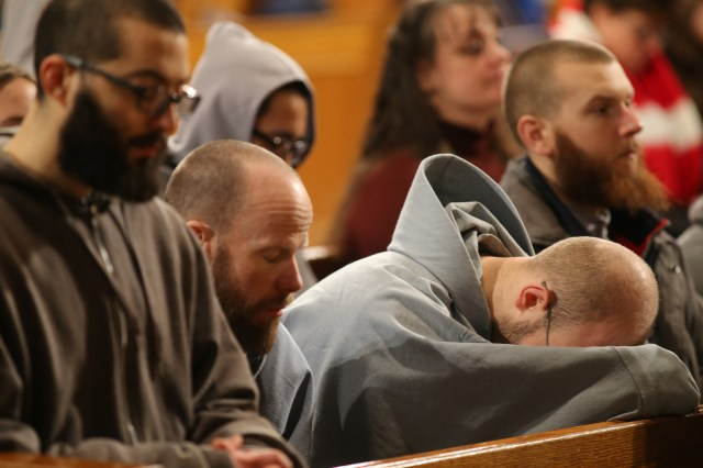 Monks pray during the closing Mass for the National Prayer Vigil for Life at the Basilica of the National Shrine of the Immaculate Conception in Washington Jan. 22. (CNS/Bob Roller)