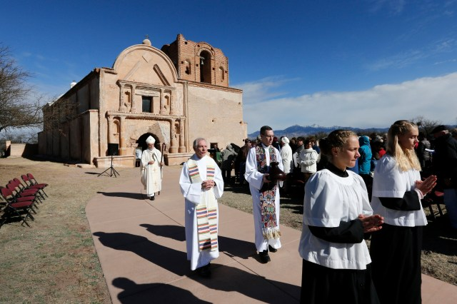 After celebrating Mass, Bishop Gerald Kicanas of Tucson, Ariz., walks with his crosier outside the mission at Tumacacori National Historical Park in Tumacacori, Ariz., this year. The Mass was part of the park's Kino Legacy Day marking the 325th anniversary of the Jesuit missionary's first visit to an O'odham village there. (CNS/Nancy Wiechec)