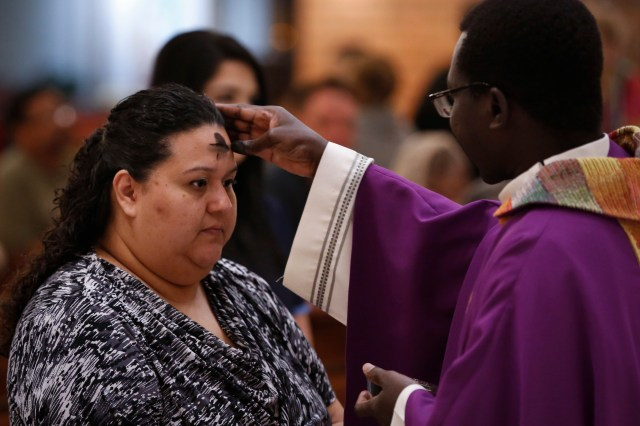 Ashes are distributed during Ash Wednesday Mass last year at St. Helen Catholic Church in Glendale, Ariz. (CNS/Nancy Wiechec)