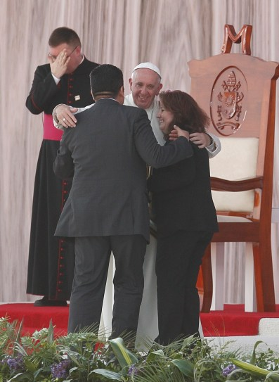Pope Francis embraces Humberto and Claudia Gomez, who are married civilly but not in the church, during a meeting with families at the Victor Manuel Reyna Stadium in Tuxtla Gutierrez, Mexico, Feb. 15. (CNS/Paul Haring)