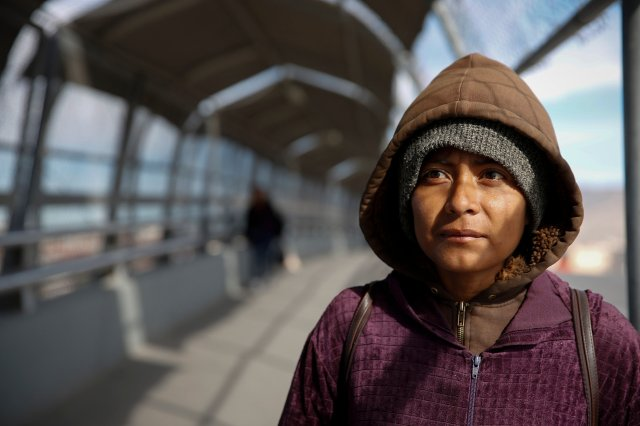 Diana Martinez stands on the bridge linking El Paso, Texas, and Juarez, Mexico, at the Paso del Nortre port of entry. She had been deported from the United States and was panhandling for money so that she could return to her home state of Chiapas in Mexico. (CNS/Nancy Wiechec)