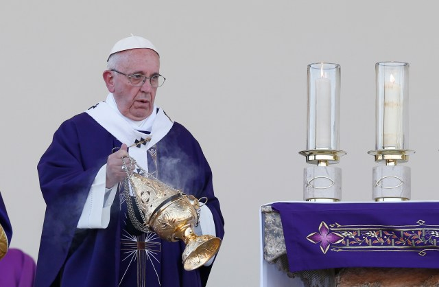 Pope Francis uses incense as he celebrates Mass at the fairgrounds in Ciudad Juarez, Mexico, Feb. 17. (CNS/Paul Haring)