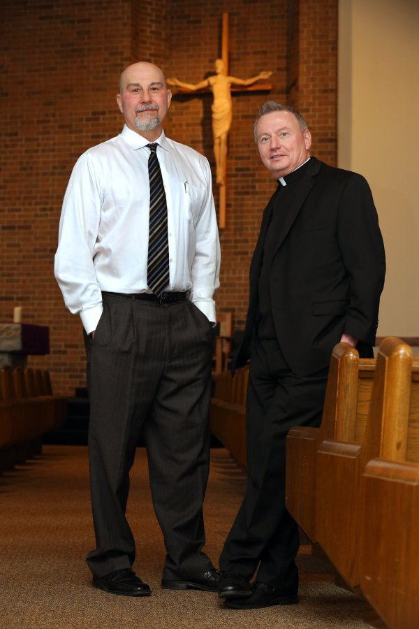 Father Neil Kookoothe, pastor of St. Clarence Parish in North Olmsted, Ohio, and former death-row inmate Joe D'Ambrosio pose for a photo. (CNS/William Rieter)
