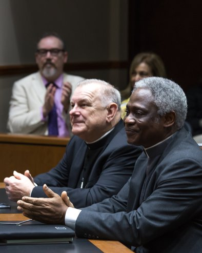 Miami Archbishop Thomas G. Wenski, left, and Ghanaian Cardinal Peter Turkson, president of the Pontifical Council for Justice and Peace, attend a two-day international conference on climate change, nature and society. (CNS/Tom Tracy)