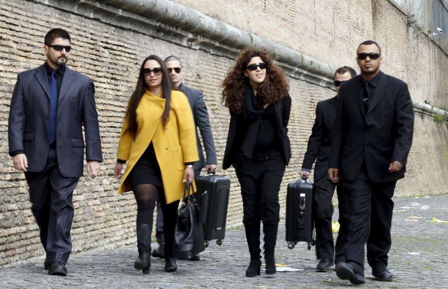 """Italian laywoman Francesca Chaouqui, second from right, and her lawyer Laura Sgro, second from left, arrive for the so-called """"Vatileaks"""" trial at the Vatican March 14. Chaouqui is one of five people on trial for leaking confidential Vatican documents that were published in two books. (CNS/Reuters)"""