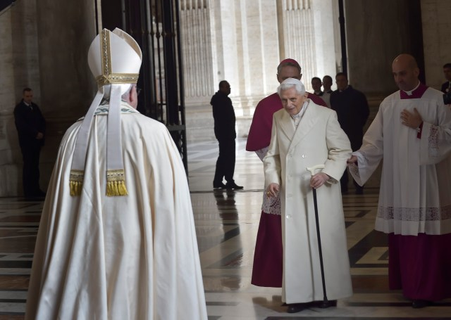 Retired Pope Benedict XVI prepares to greet Pope Francis during the opening of the Holy Door of St. Peter's Basilica in December. (CNS/Stefano Spaziani, pool)
