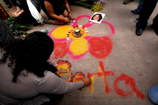 Activists draw a flower on the floor as part of a makeshift memorial for slain environmental rights activist Berta Caceres during a protest outside the morgue in Tegucigalpa, Honduras, March 3. (CNS photo/Jorge Cabrera, Reuters)