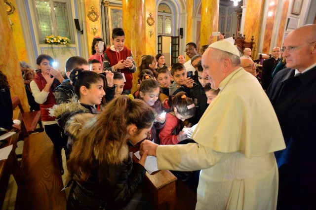In 2014, Pope Francis meets in Istanbul with young refugees from civil wars in Syria and Iraq a few hours after joining Ecumenical Patriarch Bartholomew of Constantinople to denounce the plight of Christians there. (CNS/L'Osservatore Romano)