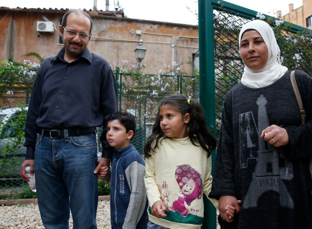 Syrian refugees Osama and Wafa and their two children, Omar, 6, and Masa, 8, are pictured in Rome. The family was among 12 refugees Pope Francis brought to Rome with him in April from a refugee camp in Lesbos, Greece. (CNS/Paul Haring)