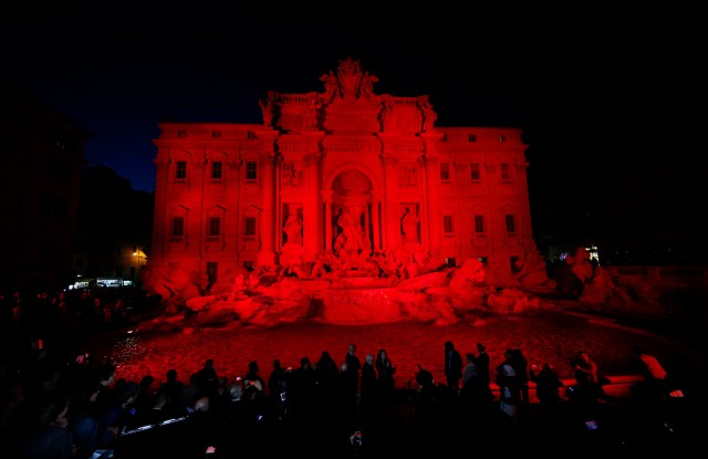 The Trevi Fountain in Rome is lit in red during an event to raise awareness of the plight of Christian martyrs April 29. (CNS/Paul Haring)