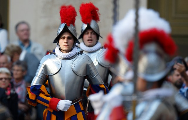 A new Swiss Guard recruit marches forward during the swearing-in ceremony for 23 new recruits at the Vatican May 6. New recruits are sworn in every year on May 6, commemorating the date in 1527 when 147 Swiss soldiers died defending the pope during an attack on Rome. (CNS/Paul Haring)