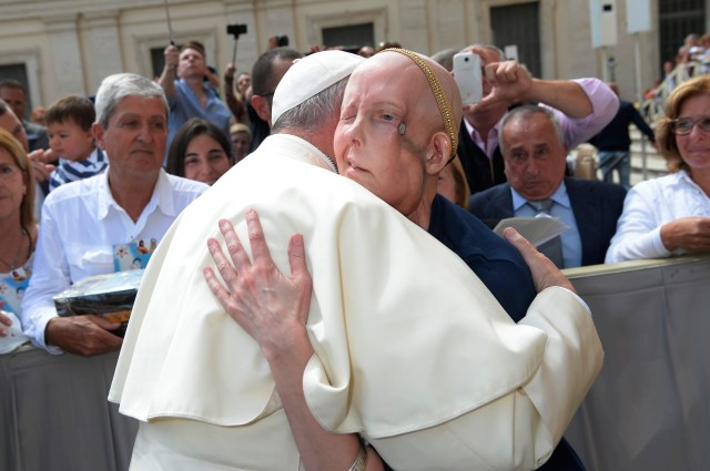 Pope Francis embraces Cheryl Tobin during his general audience at the Vatican May 11. Tobin, from Clarksville, Tenn., was visiting Rome to fulfill a dream and to pray for a miracle. (CNS/L'Osservatore Romano)