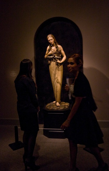 St. Mary Magdalene is shown meditating on the crucifix in this painted wooden sculpture that was part of The Sacred Made Real exhibit in 2010 at the National Gallery of Art in Washington. (CNS/Nancy Wiechec)