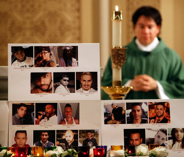 A memorial featuring the photos of the victims of the June 12 mass shooting at the Pulse nightclub in Orlando, Fla., are seen at Our Lady of Mount Carmel Church in Chicago June 19. (CNS/Karen Callaway, Catholic New World)