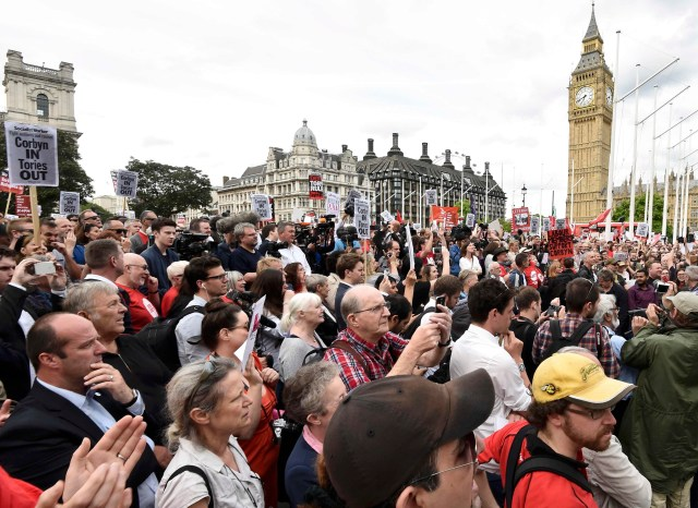 Supporters of the opposition Labor party leader Jeremy Corbyn demonstrate in London's Parliament Square. (CNS/Reuters)