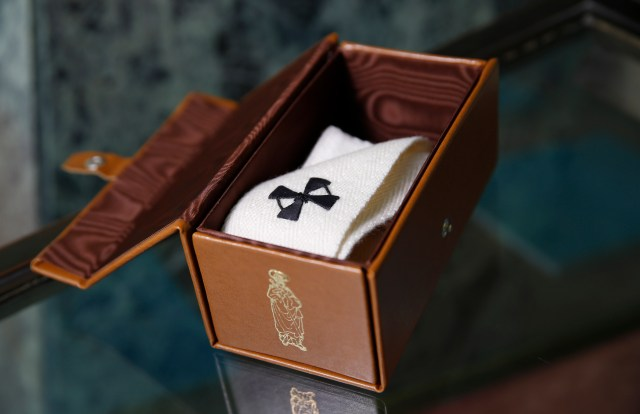 An archbishop's pallium is pictured in its leather box in Rome. After celebrating Mass June 29 for the feast of Sts. Peter and Paul and blessing the palliums, Pope Francis privately gave them to archbishops appointed in the past year. The archbishops will officially receive their palliums from a Vatican nuncio in their archdiocese. (CNS/Paul Haring)