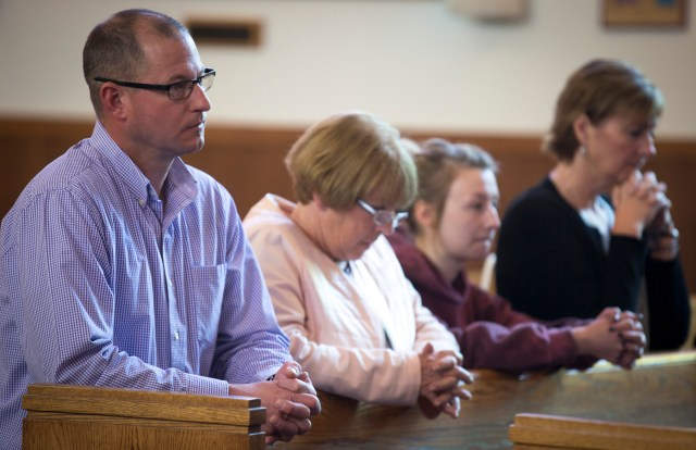 U.S. Air Force Maj. Justin Secrest and his family pray during Mass at the Malmstrom Air Force Base chapel in Great Falls, Mont. (CNS photo/Chaz Muth)