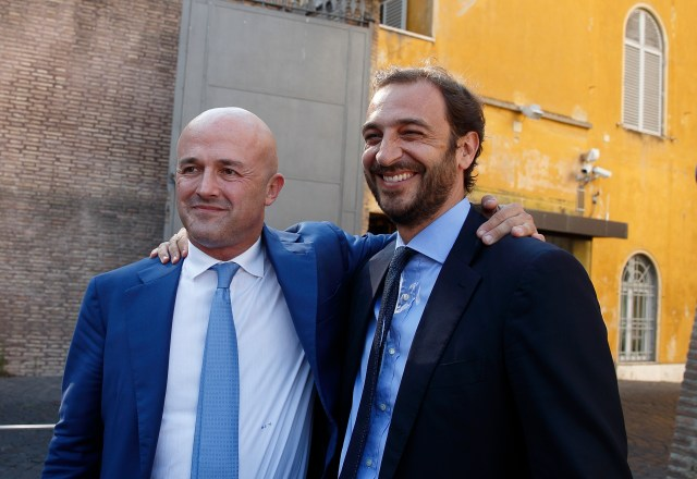 "Italian journalists Gianluigi Nuzzi and Emiliano Fittipaldi embrace after leaving the final session of the so-called ""Vatileaks"" trial at the Vatican July 7. A Vatican court, citing freedom of the press, acquitted the two journalists who published confidential Vatican documents. Their source, Spanish Msgr. Lucio Vallejo Balda, was sentenced to 18 months behind bars. (CNS photo/Paul Haring)"