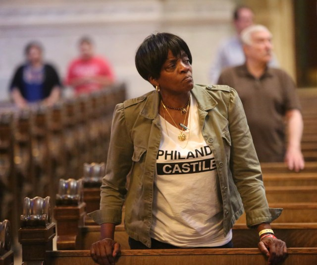 Sharon James-Abba listens to Archbishop Bernard A. Hebda of St. Paul and Minneapolis during a Mass for peace and justice at the Cathedral of St. Paul. The Mass was offered in response to the July 6 shooting death of St. Paul resident Philando Castile by a police officer. (CNS/Dave Hrbacek, The Catholic Spirit)