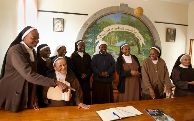The Carmelite Sisters of Mount Carmel Convent in Nairobi, Kenya, ask their visitors from the United States to sign their guest book in this 2011 file photo. Pope Francis issued a series of new rulings dealing with formation, assets, prayer life, authority and autonomy of contemplative women. (CNS/Nancy Wiechec)