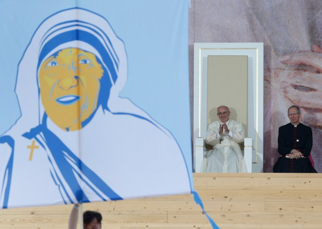 Pope Francis applauds as a banner showing Blessed Mother Teresa is presented during the World Youth Day welcoming ceremony in Blonia Park in Krakow, Poland, July 28. (CNS/Paul Haring)