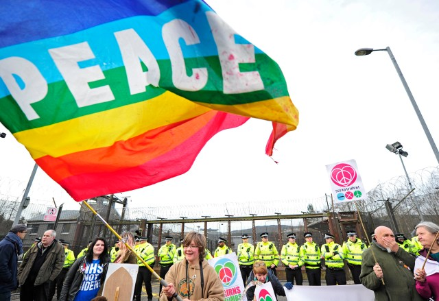 Protesters stage a sit-in at Faslane Naval Base in Helensburgh, Scotland, April 13, 2015. (CNS photo/Joey Kelly, EPA)