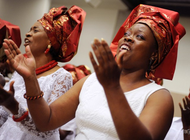 Mary Kiganda, right, and Carolyn Ohams, both from the Archdiocese of Washington, sing Aug. 5 during the opening Mass of the Third African National Eucharistic Congress at The Catholic University of America in Washington. (CNS/Leslie E. Kossoff)