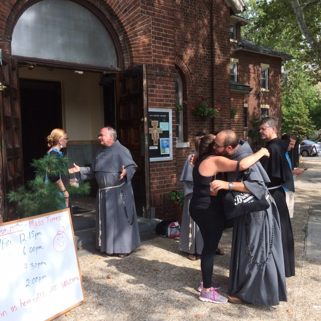 Conventual Franciscan friars greet residents of the Greenpoint/Williamsburg section of Brooklyn, N.Y., in 2015 shortly after they opened their San Damiano Mission in the neighborhood, which had been the Holy Family (Slovak) Church. (CNS/Ed Wilkinson)