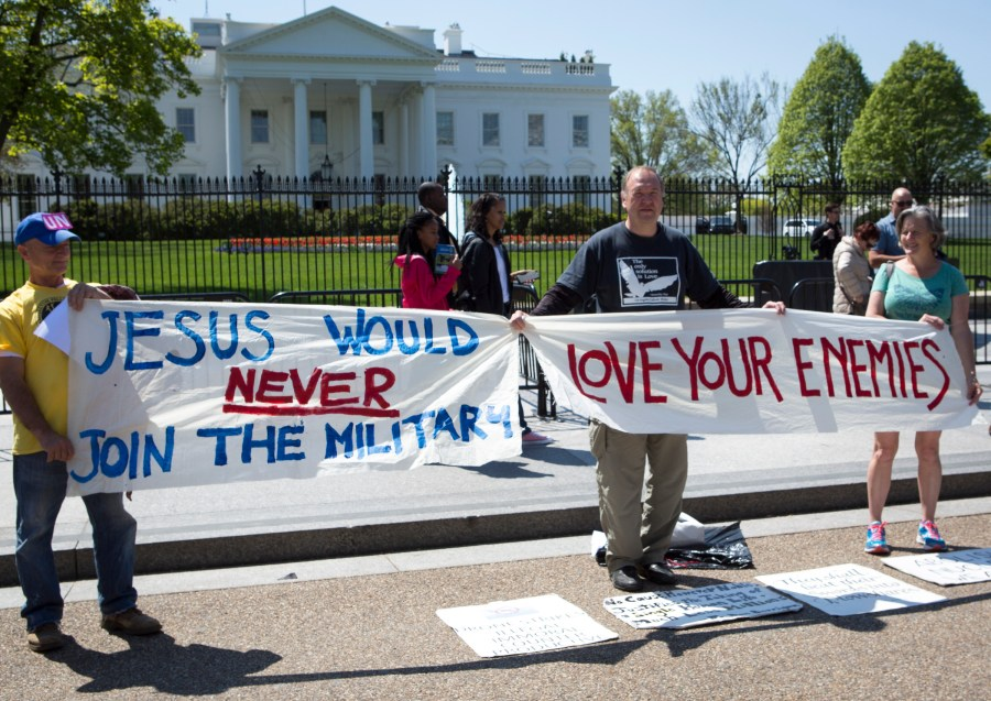 Art Laffin, center, of the Dorothy Day Catholic Worker community, participates in a protest for peace with other demonstrators outside of the White House. (CNS/Chaz Muth)
