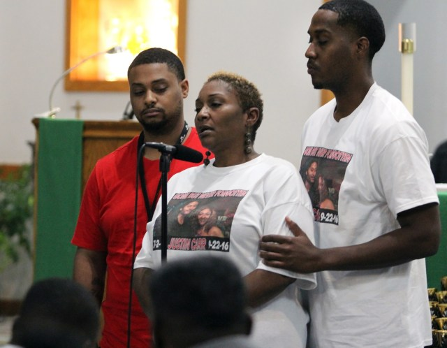 Vivian Carr and her sons Kenneth Johnston and Ellis Carr speak during a Sept. 23 prayer service at Our Lady of Consolation Catholic Church in Charlotte, N.C. The previous day Vivian's other son, Justin Carr, died from a gunshot wound to the head that he received during protests in Charlotte which turned violent following the fatal police shooting of an African-American man. (CNS photo/Patricia L. Guilfoyle, Catholic Herald)