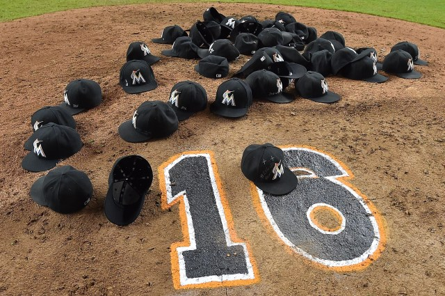 Hats of the Miami Marlins lay on the pitcher's mound Sept. 26 after the game to honor pitcher Jose Fernandez at Marlins Park. (CNS photo/Jasen Vinlove, USA TODAY Sports via Reuters)